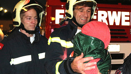 Firemen rescue toddler from post box