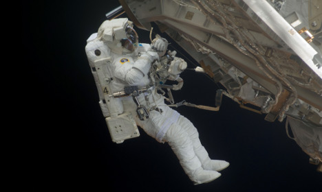 Astronaut helps launch first student satellite