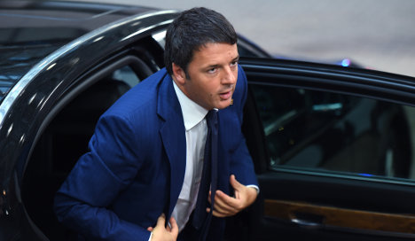 Angry protesters pelt Renzi's car with eggs