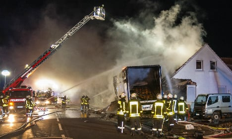 Couple awake to flaming lorry in the house