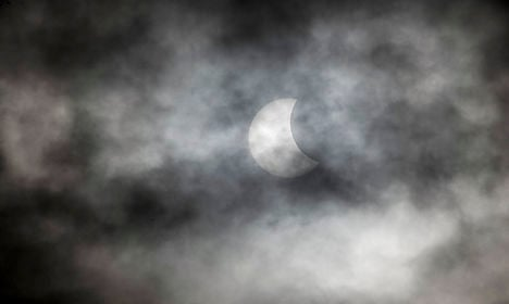 Denmark's solar eclipse lost in the clouds