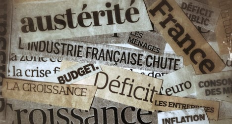French government hails cut in public deficit