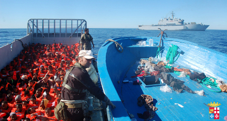 Italy-bound migrants rescued as boat sinks