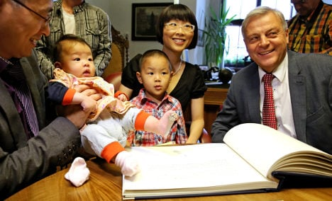 Chinese pair name kids after east German town