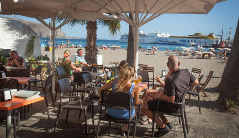 Tourist spending in Spain sets new record, boosting economic recovery