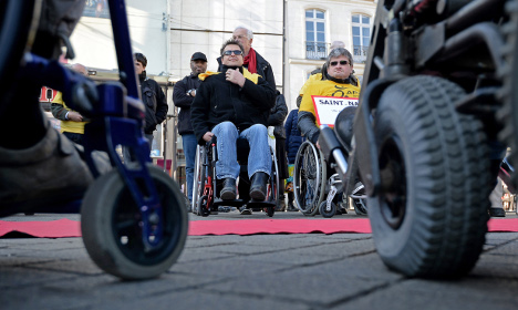 France's disabled forced into 'exile' in Belgium