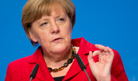 I'm not scared of polls or my own party: Merkel