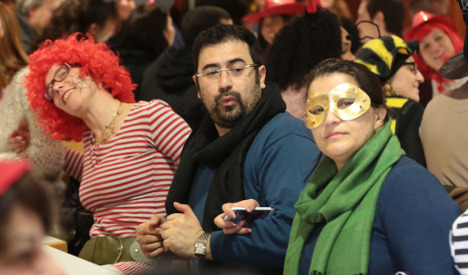 Cologne locals take refugees under their wing for Karneval
