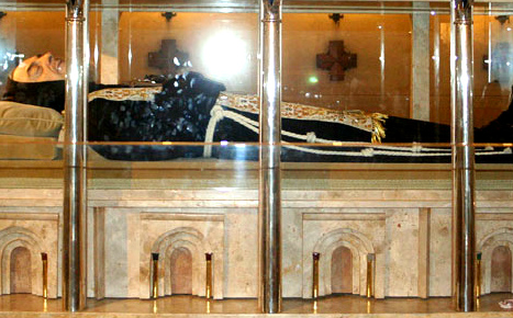 Italy ups security as beloved saint's body moves to Rome