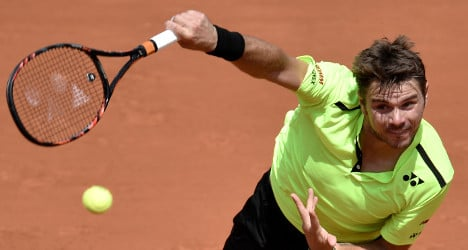 Wawrinka eases into third round in Paris