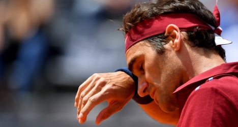 Austrian triumphs over ailing Federer in Rome