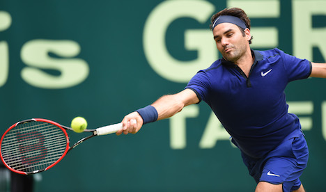 Federer ousts Goffin to reach Halle semis