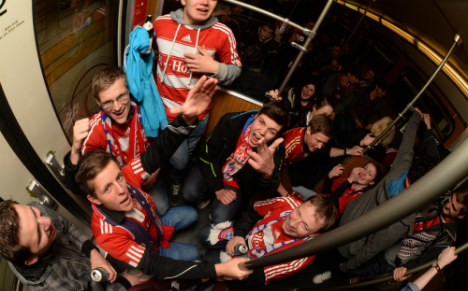 Bayern fans flee after getting trapped in overheated train