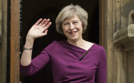 May to thrash out Brexit roadmap in Berlin, Paris talks
