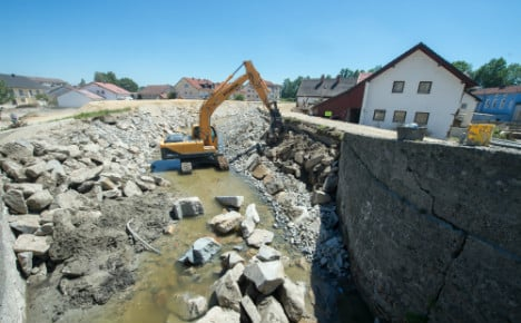 Town ravaged by floods tries to pick up the pieces
