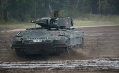 Two injured after army tank falls 50 metres in Alps
