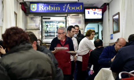 Madrid homeless dine out… for free