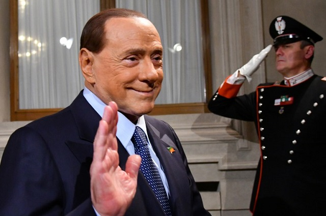 Woman buys €70,000 lunch with Berlusconi to aid quake victims
