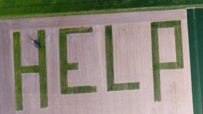 French farmer transforms wheat field into gigantic 'HELP' plea to candidates