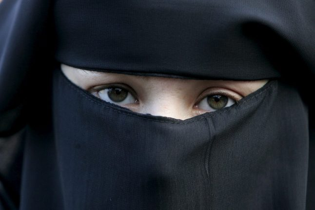 German parliament passes partial burqa ban for officers, soldiers