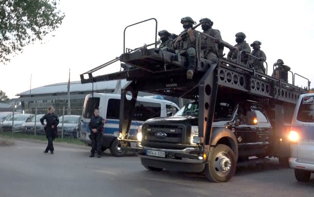 Police storm Hells Angels clubhouse with armoured vehicle