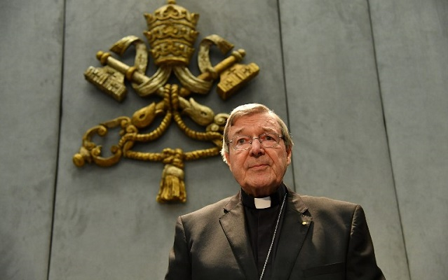 Cardinal Pell returns to Australia to face sex abuse charges