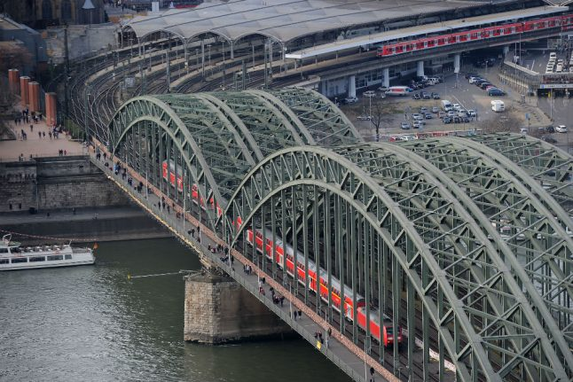 Hours of train delays in Cologne after asylum seeker protests on busy bridge