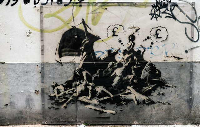 Banksy mural in Calais wiped out by house painters