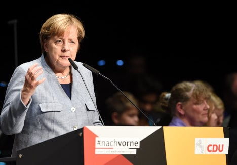 Merkel faces test in state vote before tough coalition talks