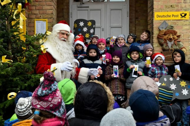 Wish lists from children worldwide pile up at Santa's post offices in Germany