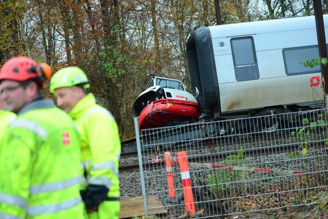 Several taken to hospital after Danish train collides with digger