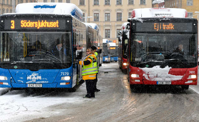 Traffic chaos arrives with first snow in Stockholm: in pictures