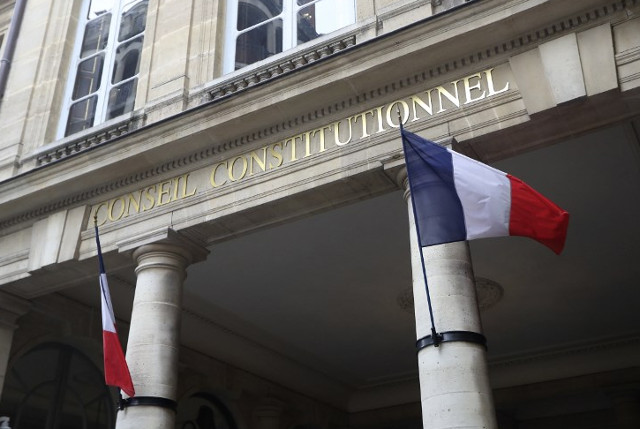 France hikes taxes on big companies to meet deficit goal