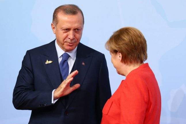 Erdogan holds out olive branch to Germany after fractious year
