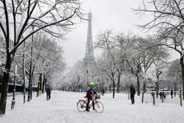 In pictures: Paris wakes up to spectacular snowy scenes