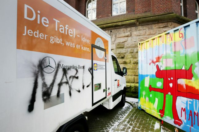 'Nazi' sprayed on food charity which refused to take new migrant clients