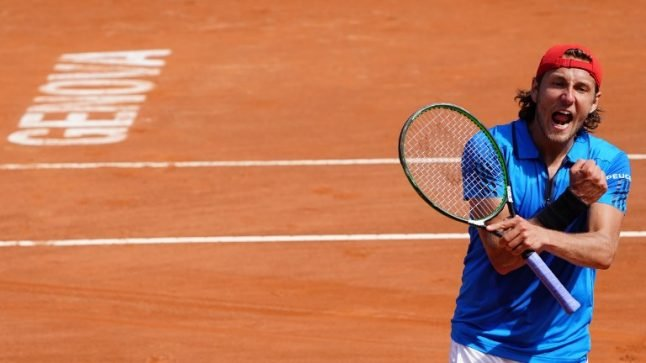 Pouille sends France past Italy and into Davis Cup semi-finals