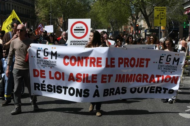 Macron's party divided as France debates immigration law