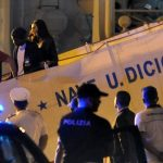 Migrants disembark coast guard ship in Sicily after reports of violence