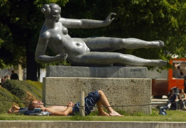Can people go topless in French towns in the summer?