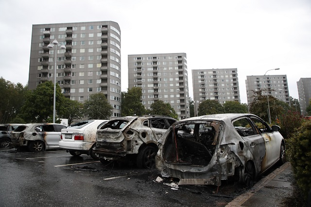 What's behind the car burnings in western Sweden?