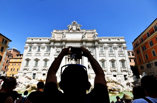 From selfie brawls to midnight swims: Tourists behaving badly at Rome's Trevi Fountain