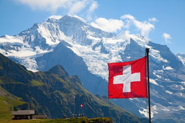 Largest Swiss flag in the world damaged by torrential rain in the Alps