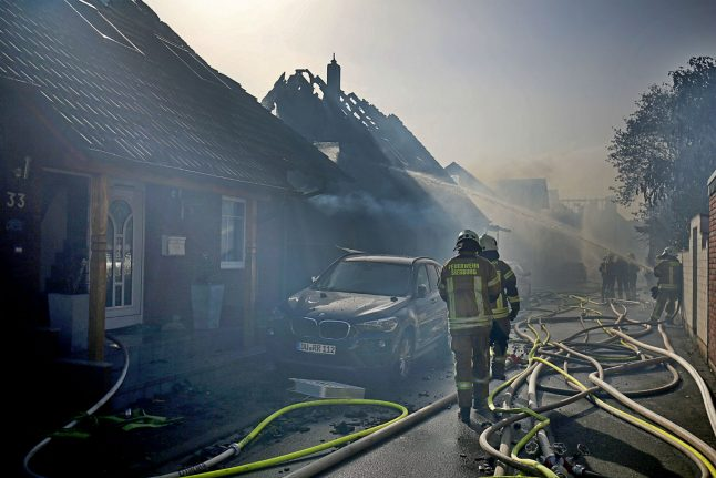 Fire next to high-speed rail track rips through houses, injuring 32