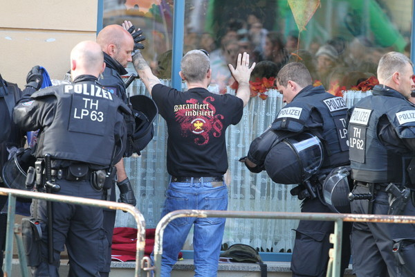 Eight police hurt in clashes at far-right gig in Germany