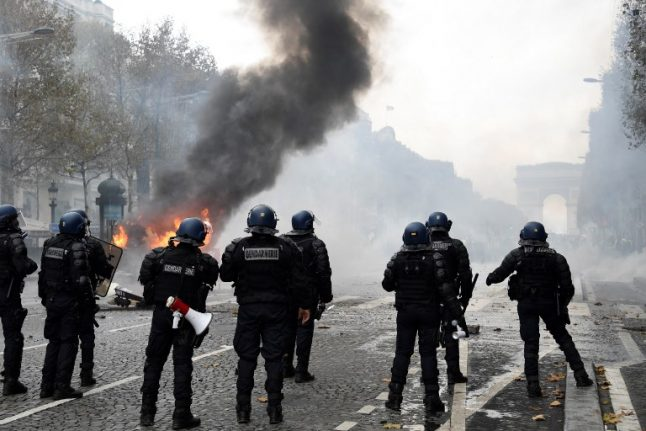 IN IMAGES: Burning barricades, tear gas and water cannon – The battle of the Champs-Elysées