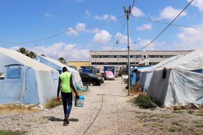 18-year-old killed in blaze at migrant tent camp