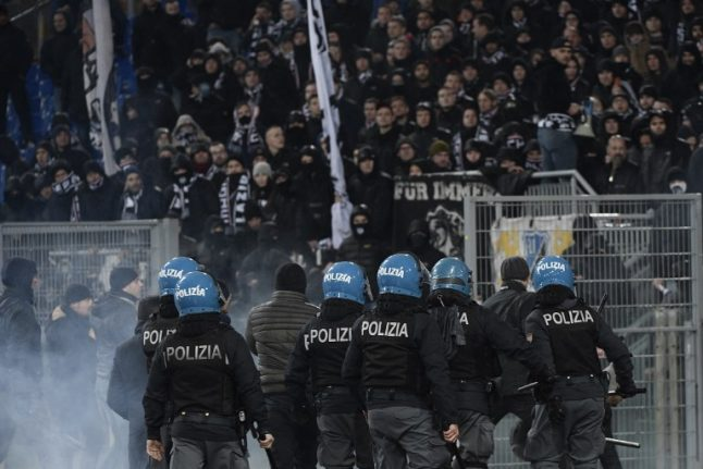 Italian police arrest rowdy German football fans after clashes in Rome