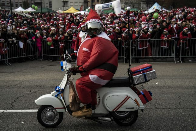 Santas rally for charity in Italy