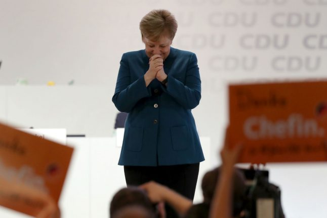 Merkel stresses 'Christian, democratic values' as she quits party leadership